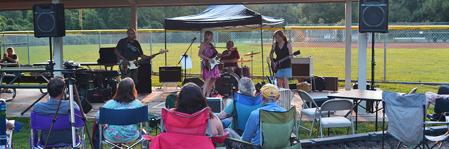 people listen to music band at Azalea park