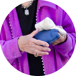 A Senior Holding a Cornhole Bean Bag